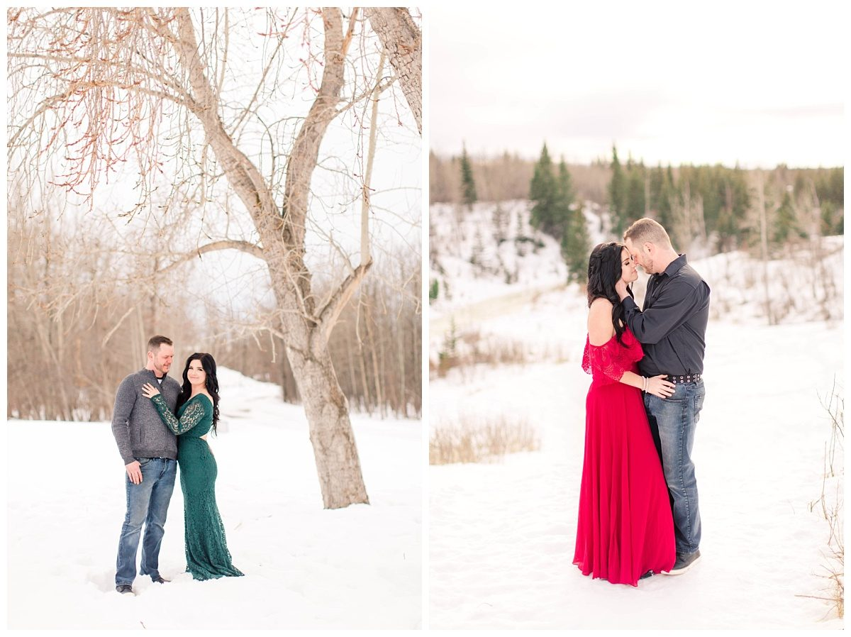 romantic winter engagement photos with emerald green dress and red dress going nose to nose pose overlooking the south bear creek in grande prairie alberta