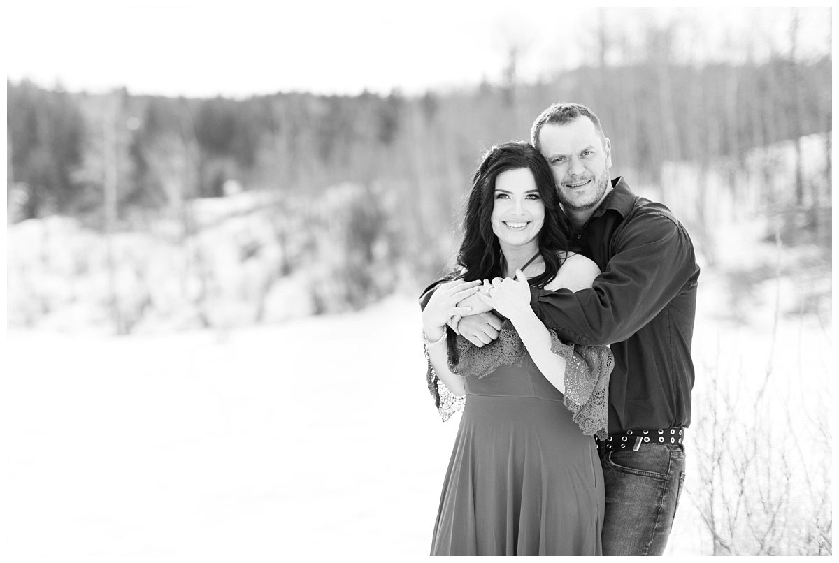 amanda and corwin bride and groom in grande prairie grande cache couple black and white photos smiling at the camera at the south bear creek