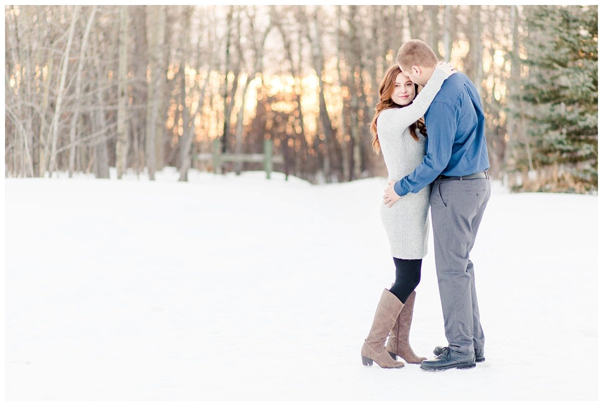 couple in the snow for their engagement photos in grande prairie steven and gina