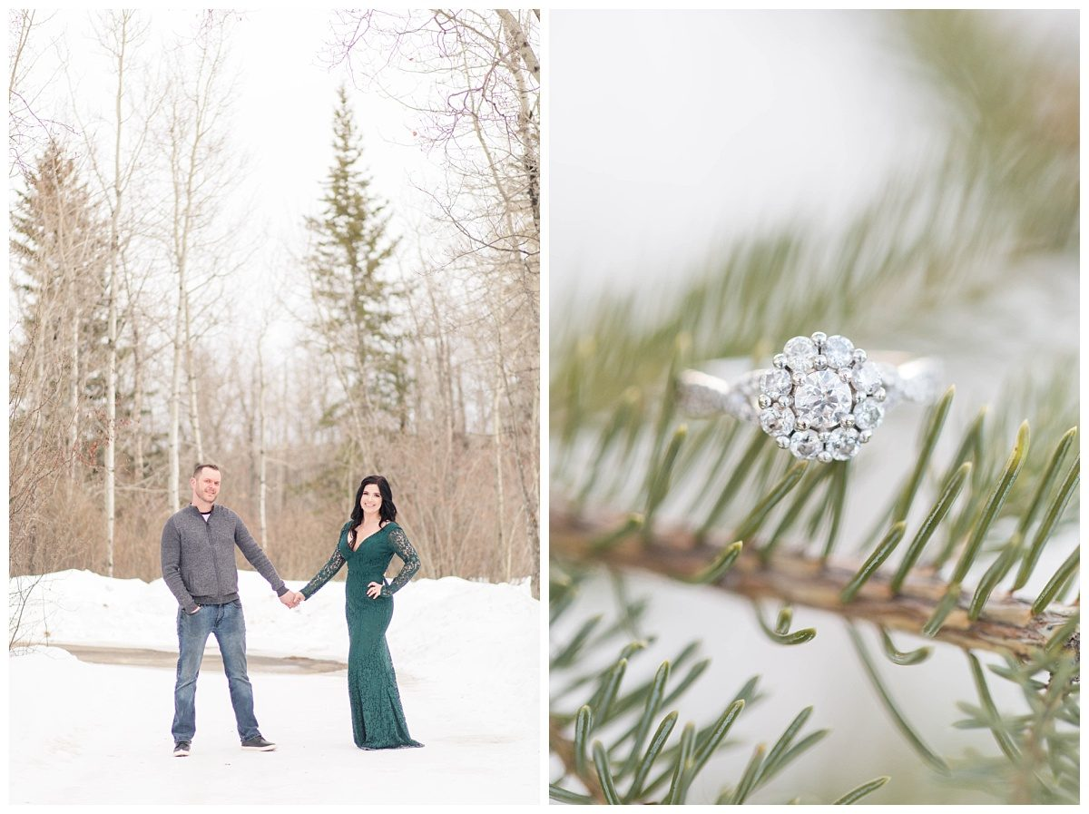 wide landscape photo winter engagement wearing long sleeve green lace lulus dress in grande prairie with engagement ring on a spruce trees close up photo in the snow