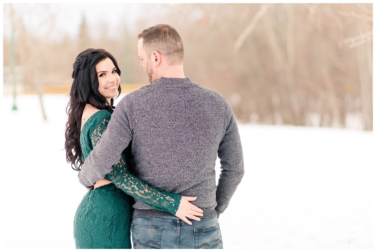 amanda and corwin backs arms wrapped around pose grande prairie winters couple photos against the snow
