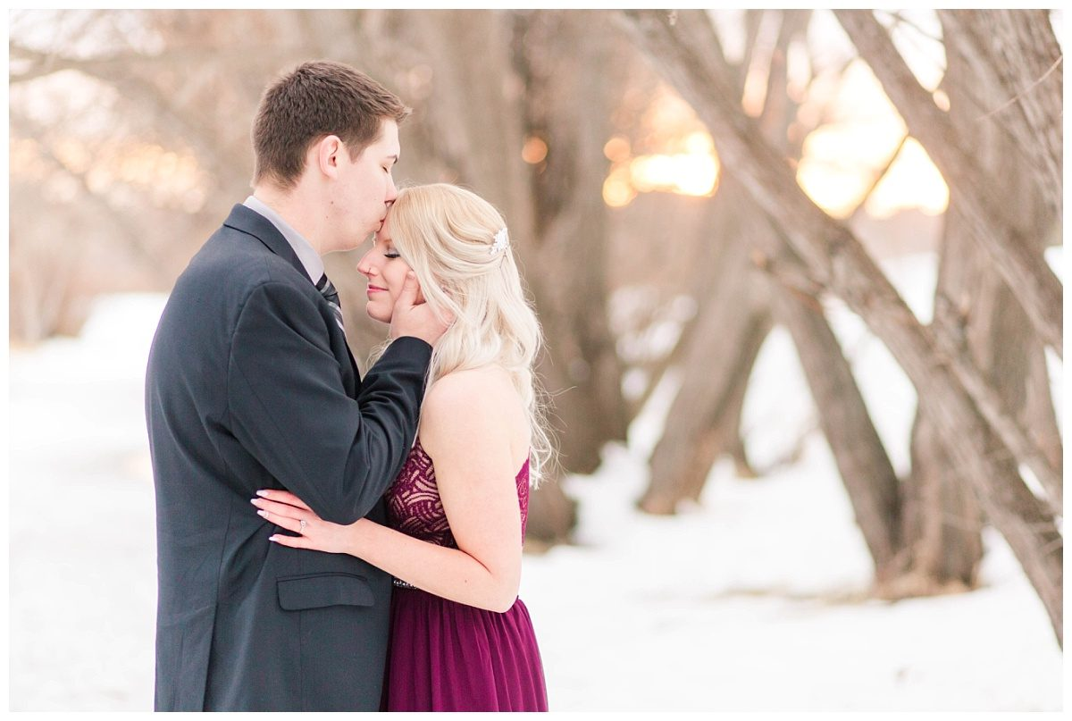 close up couple photo at engagement session chris kissing kaytlins forhead super romantic in grande prairie alberta at muskoseepi park