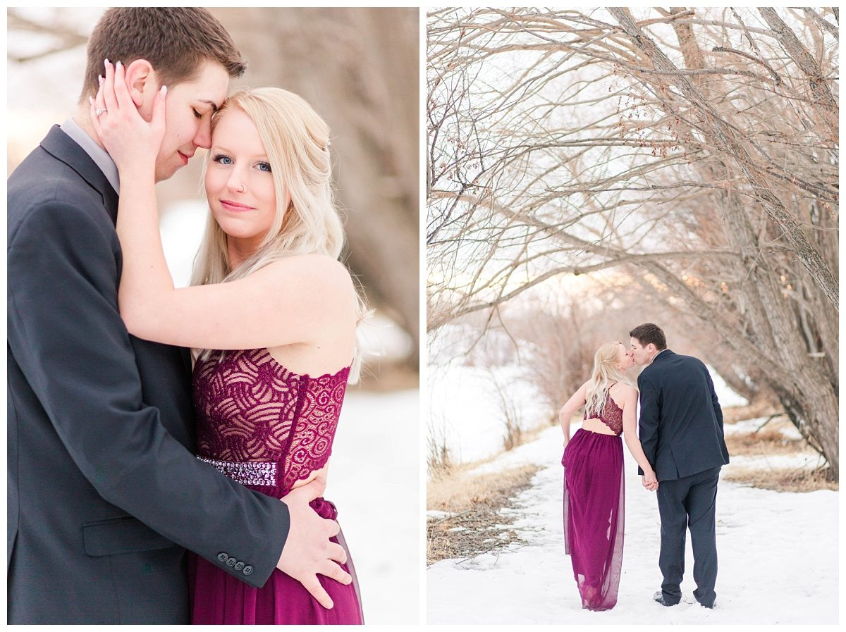 engaged couple walking away and kissing bride has blond hair with maroon long maxi dress from le chateau