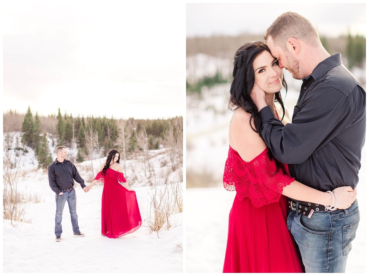 amanda wearing red dress overlooking the south bear creek in grande prairie romantic pose groom nuzzling close up