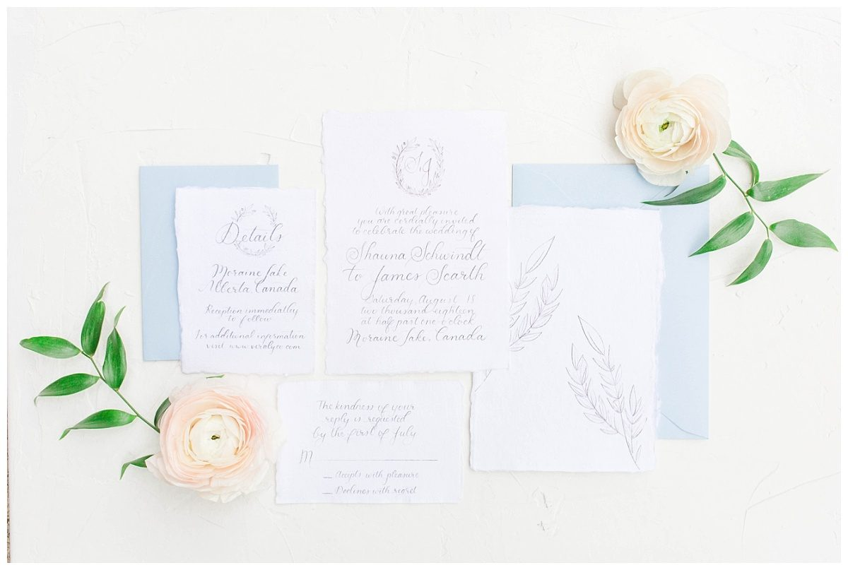 elegant invitation suite with flowers photographer captured detail photos for wedding in alberta banff