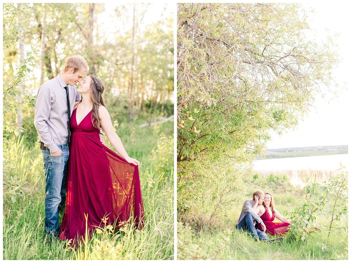 creative photos with couple in red dress by the lake sitting down for their engagement photos in grande prairie