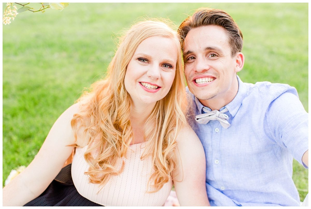 kyle and laurella smiling at the camera for their engagement session very cute couple