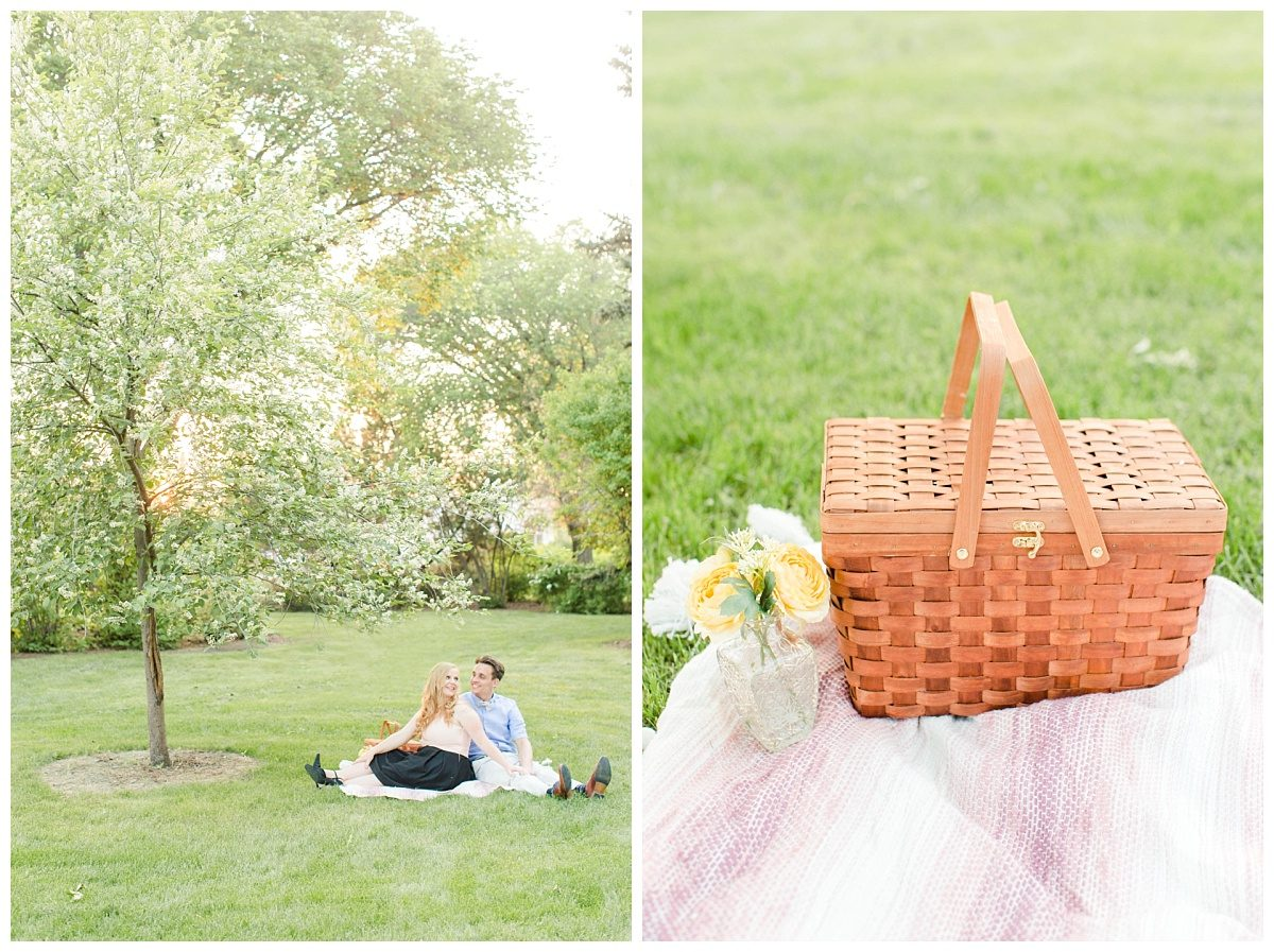 picnic theme engagement session in grande prairie alberta with photographer that captures wedding with cute picnic basket and a wide shot of couple sitting on blanket with the blossoms