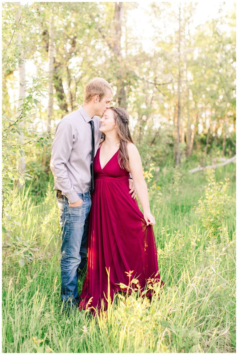 danial and shelbee engagement photos forhead kiss red dress fancy outfits