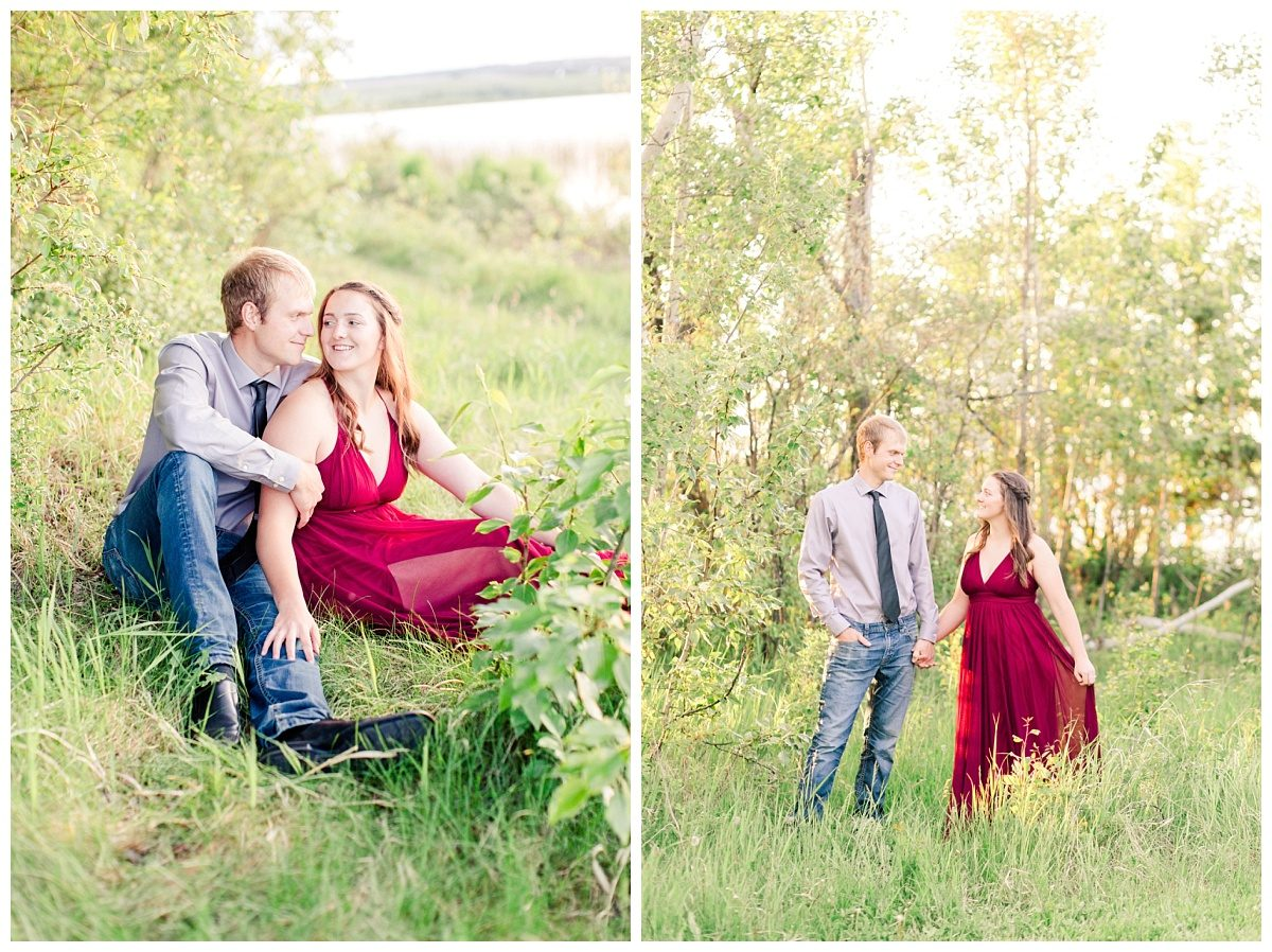 shelbee and danial holding hands surrounded by greenery in grande prairie location by the lake