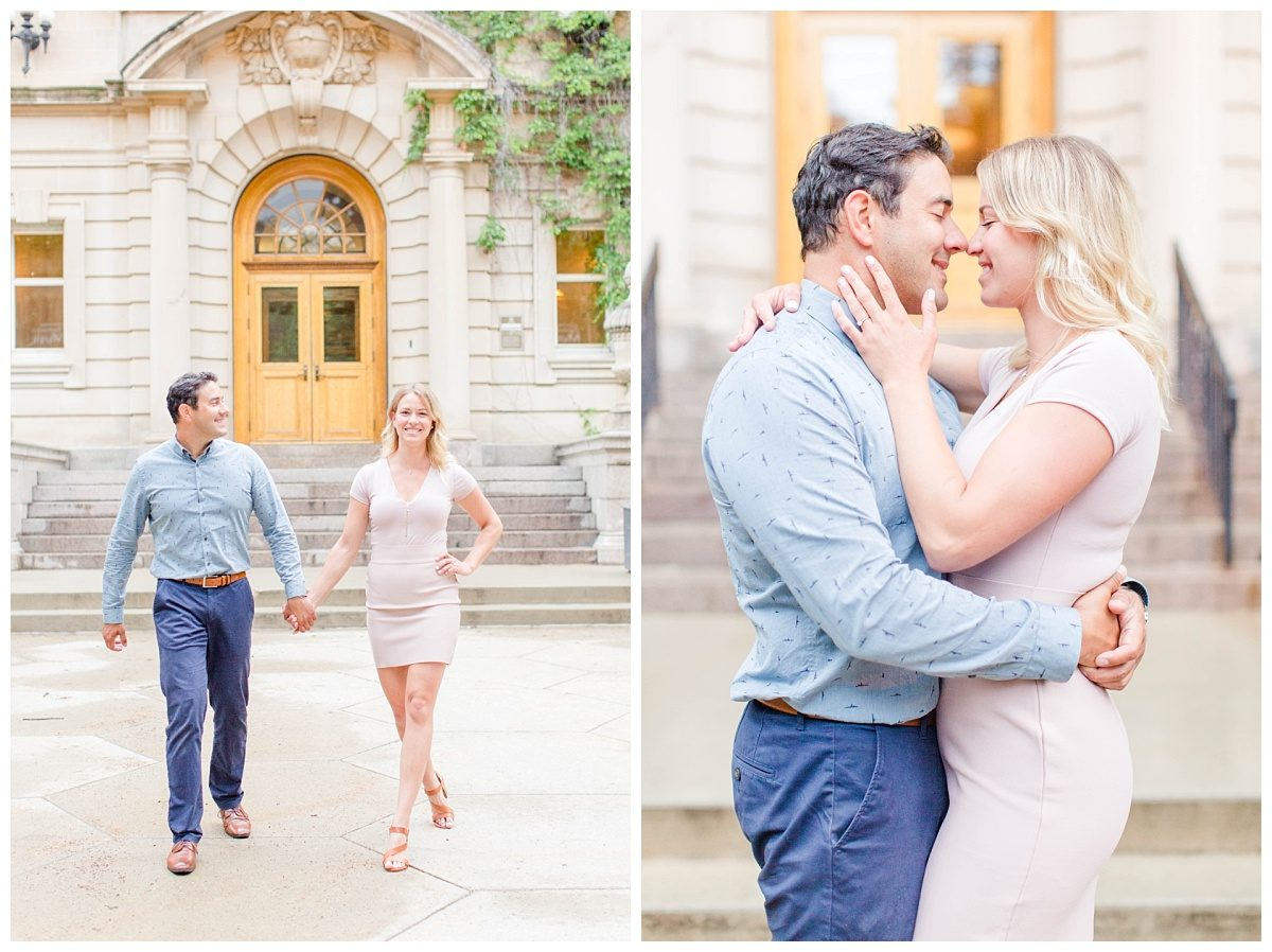couple in front of university of alberta blush and navy edmonton holding hands and walking close up photo nose to nose very romantic with soft colors