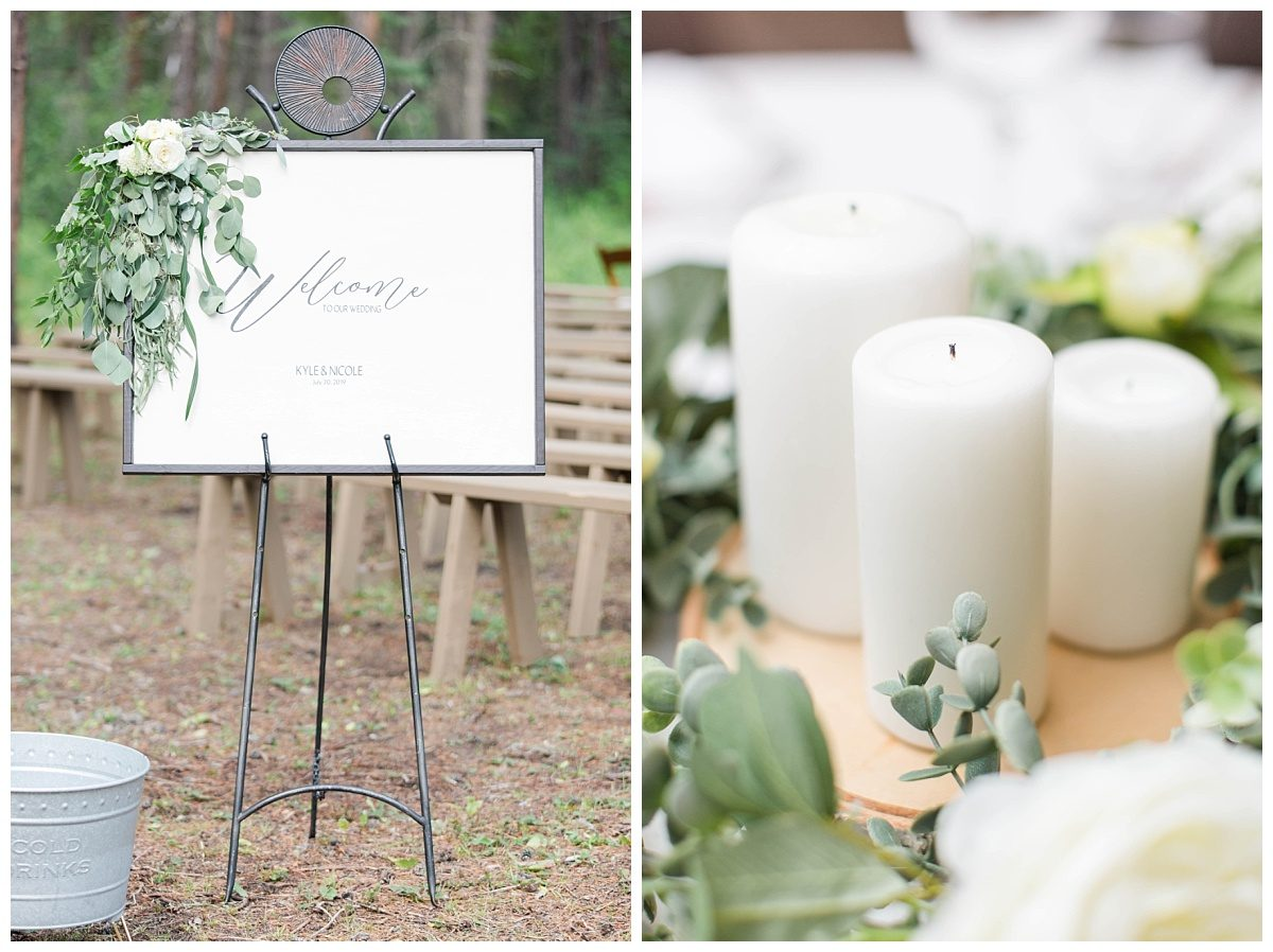 wedding decor rentals with white candles and sign by wedding planner changing dreams to reality in grande prairie at clarkson hall