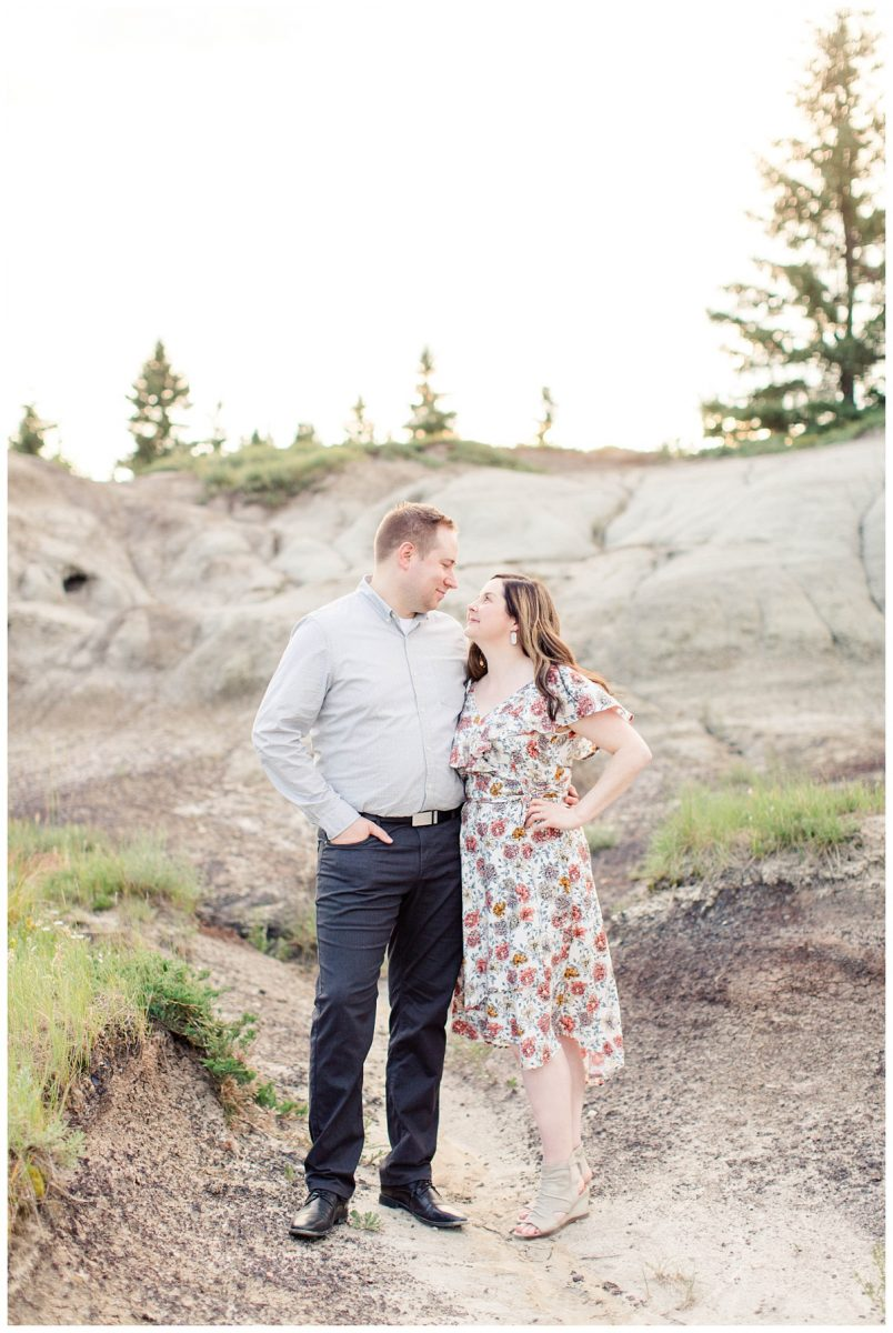drumheller kleskun hills badlands engagement photos couple smiling at each other