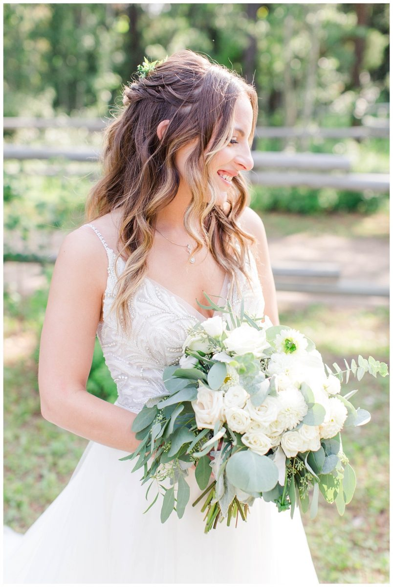 beautiful bride and bouquet by growers direct grande prairie very elegant white and eucalyptus flowers and greenery
