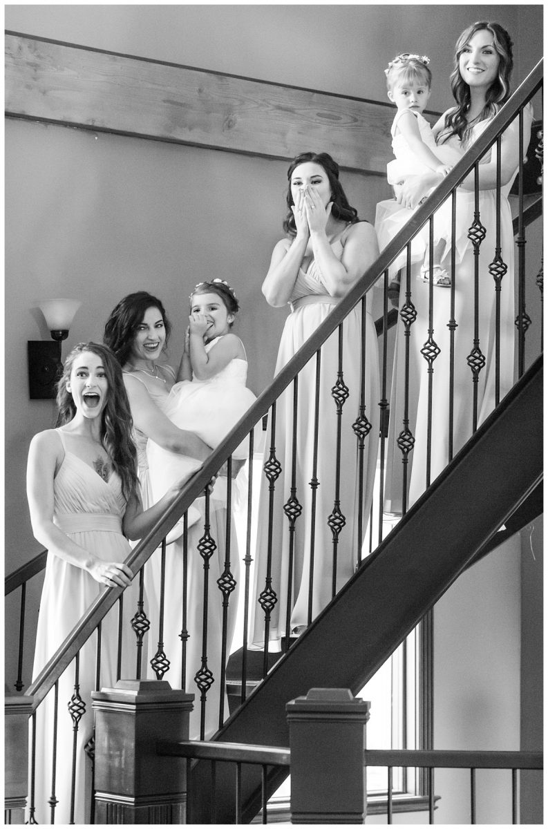first look with bridemaids getting ready in grande prairie for wedding photography emotion