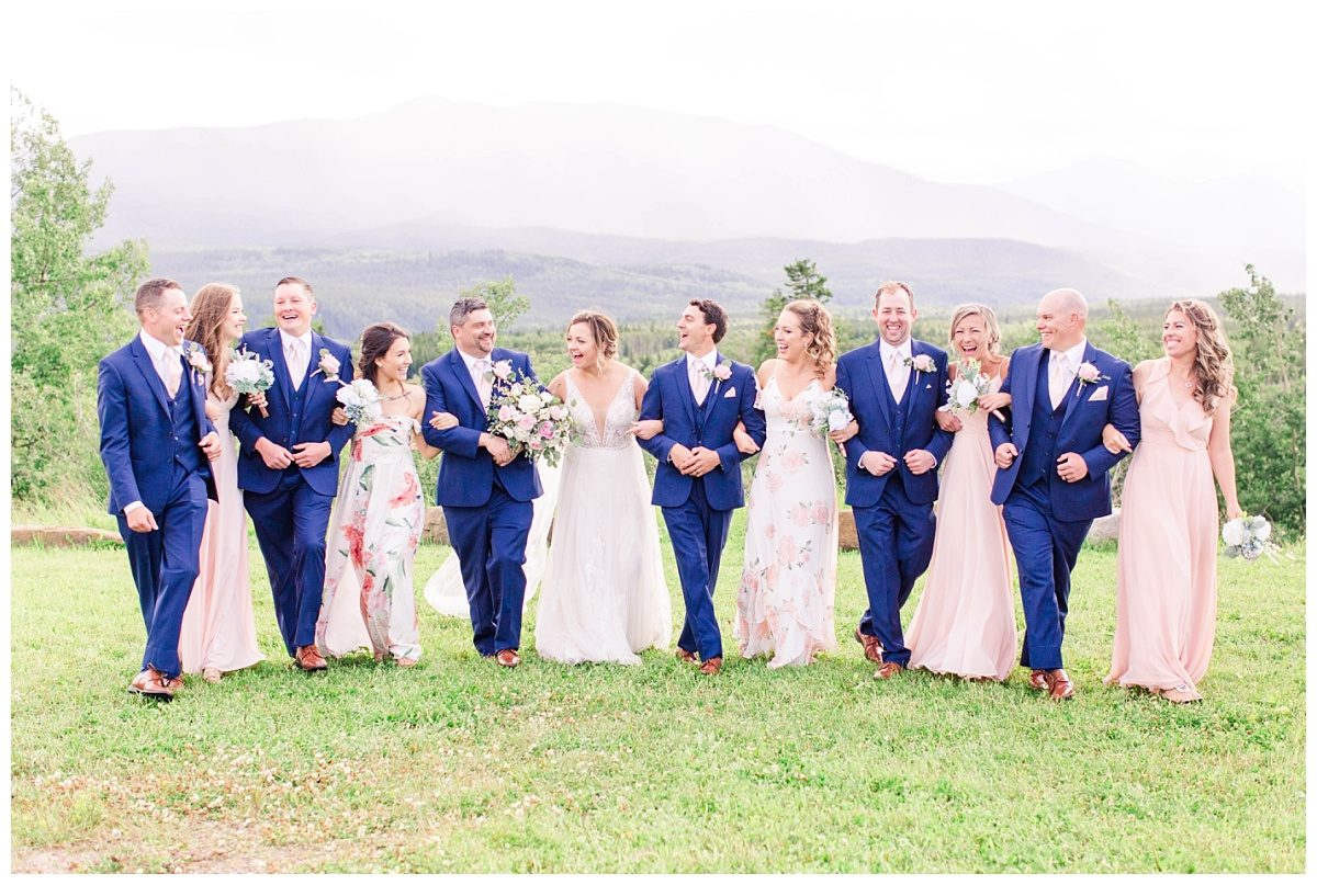 bridal party photos ceremony venue labyrinth in grande cache with mountains in the background