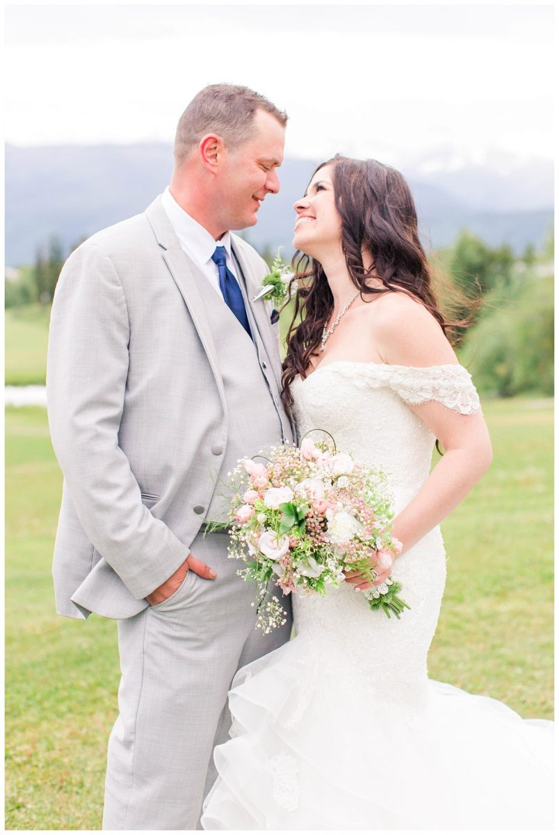 bride and groom close up photo smiling at each other in grande cache