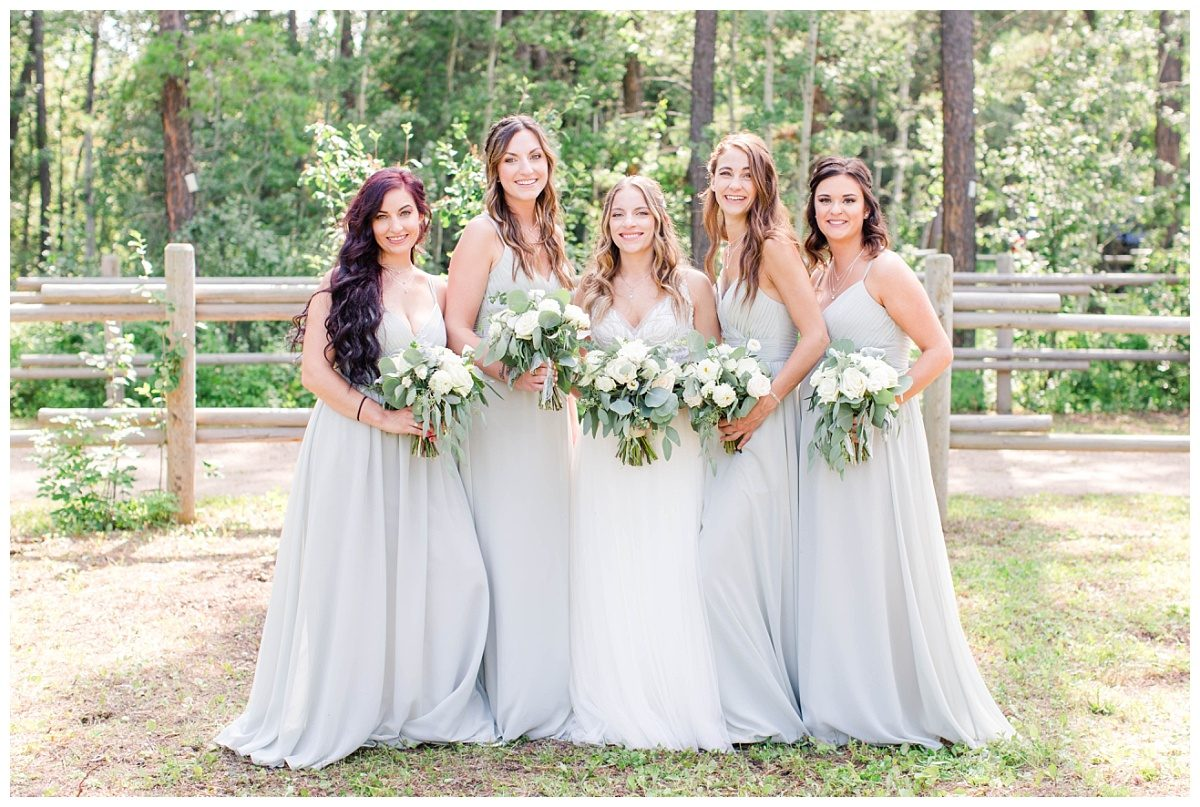 elegant wedding party bridemaids with mint dress in grande prairie