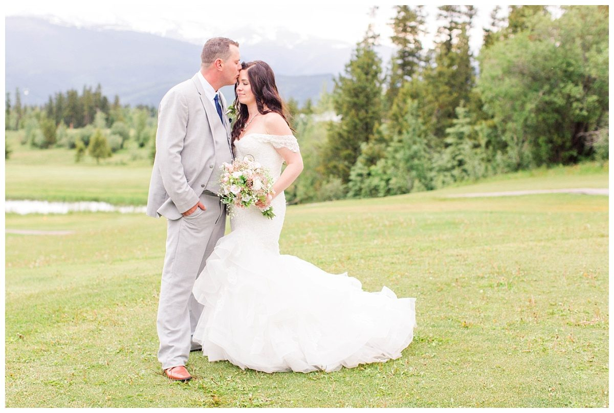 forehead kiss from the groom very romantic photo in the canadian rockies