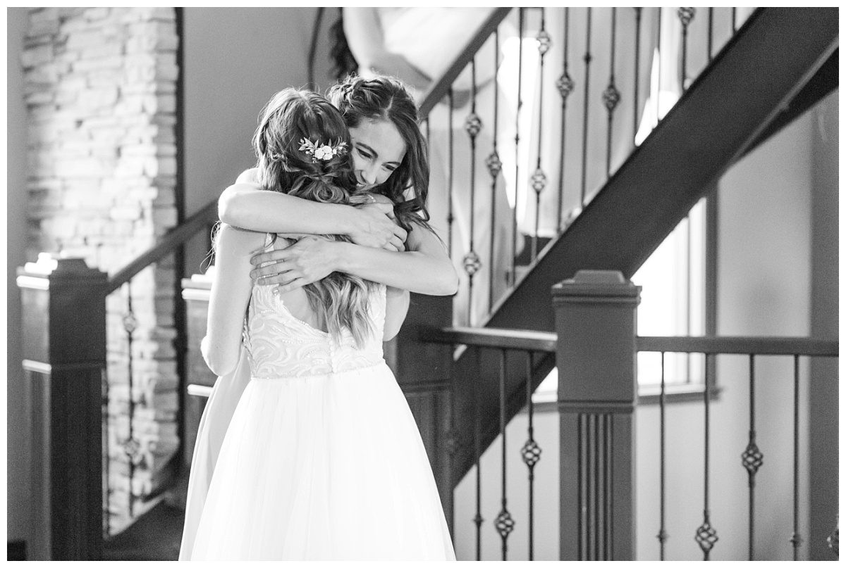 bride hugging her sister first look