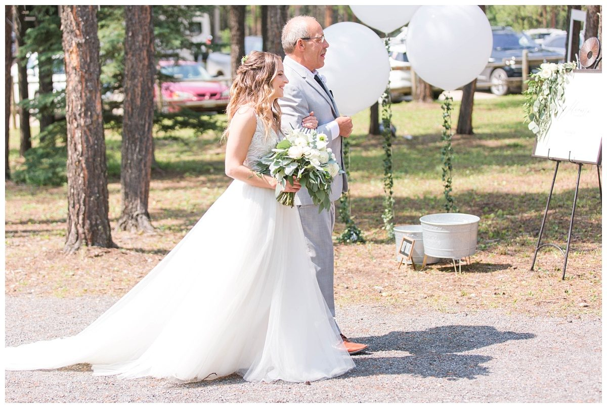 dad walking bride down the aisle at clarkson hall wedding venue in grande prairie