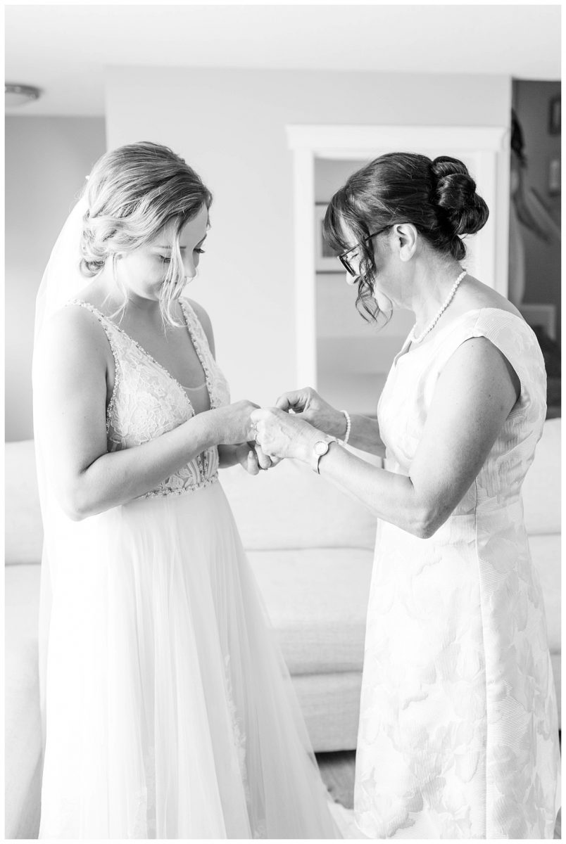 mom putting on brides bracelet getting ready black and white very classic
