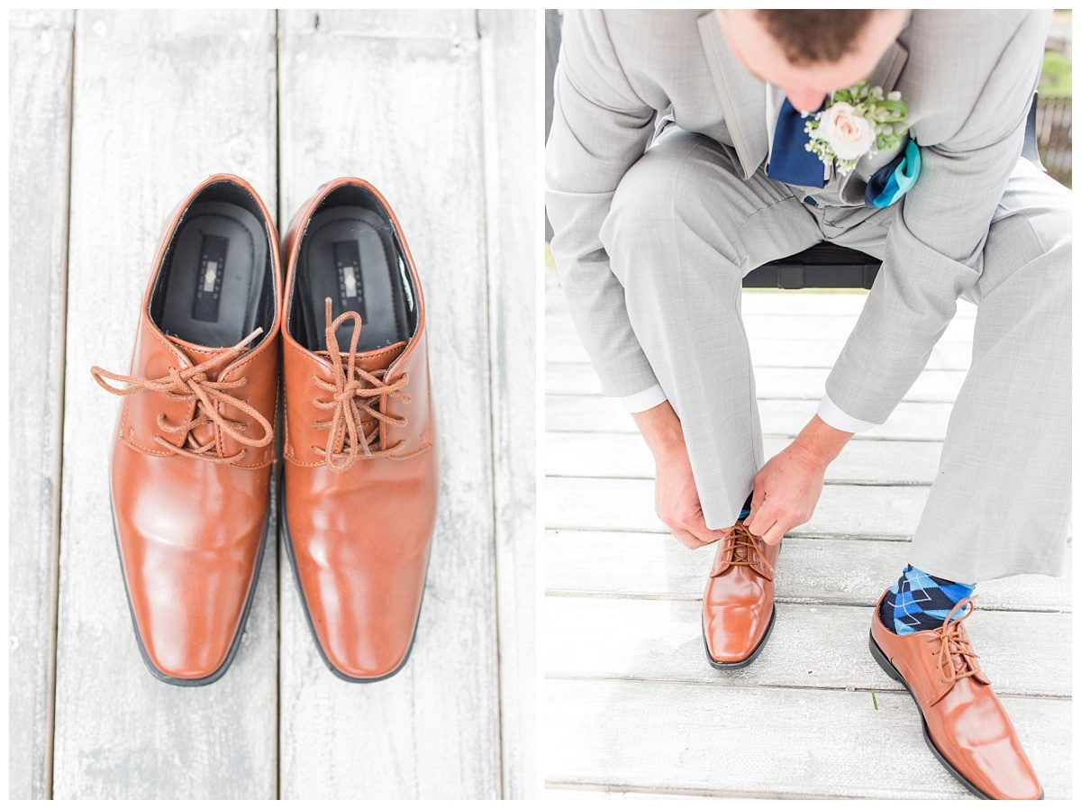 detail of the shoes groom putting on shoes on the desk brown shoes
