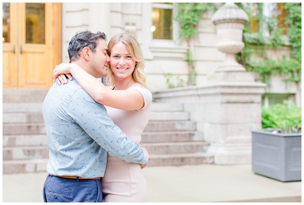 close up photo in edmonton for their engagement with light and airy feel girl blond hair blush and navy