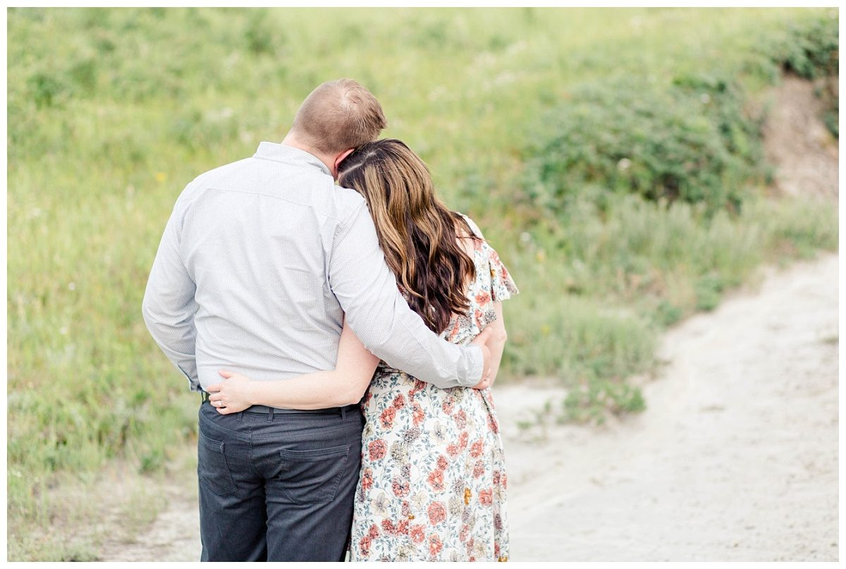 engagement couple in grande prairie cute photo arms around each other