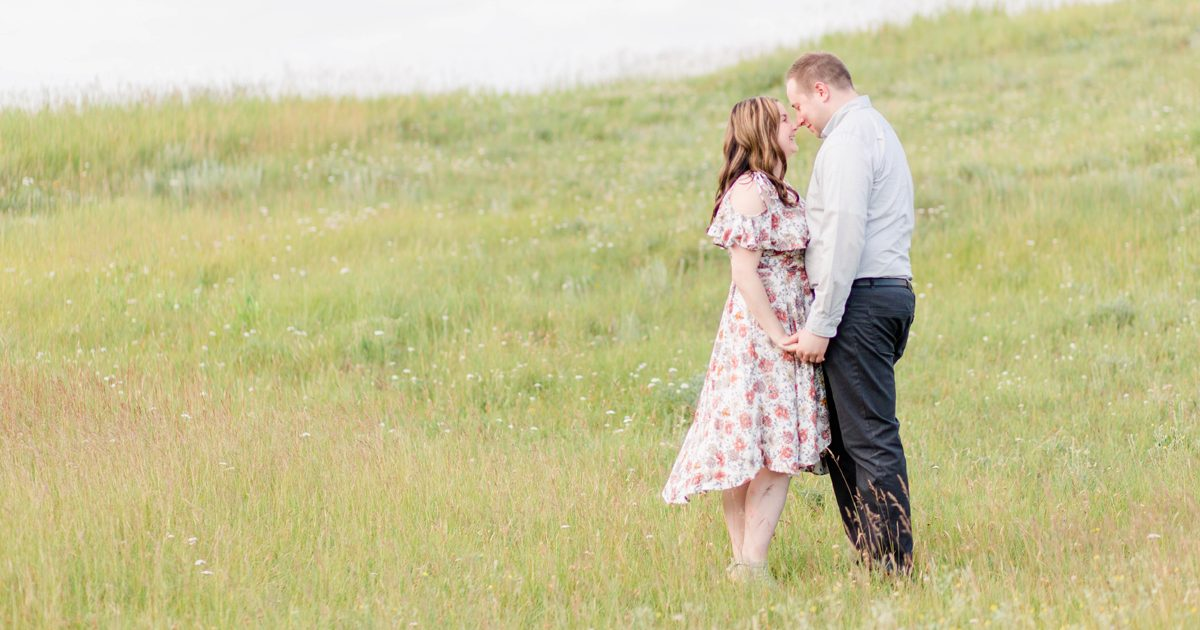 couple getting married at the bear creek golf course in grande prairie klesku hills for their engagement session very light and airy