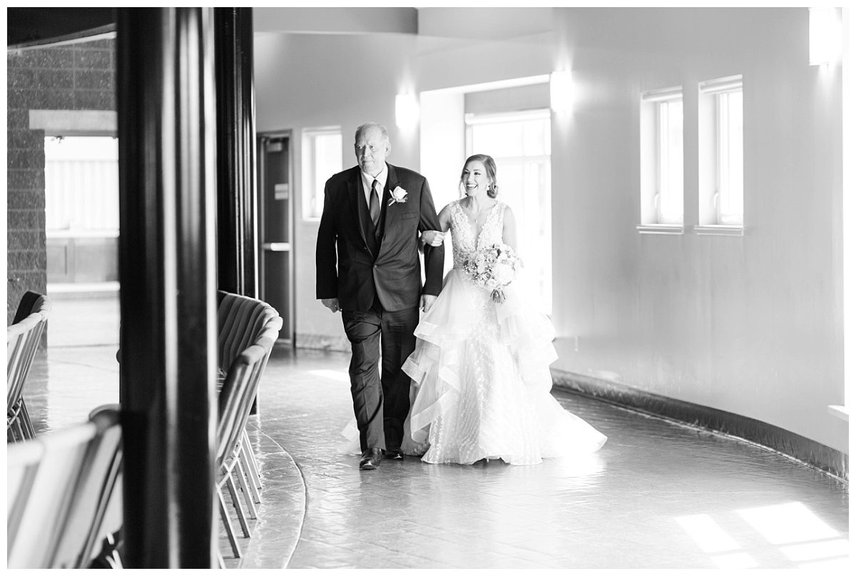 grande prairie peoples church wedding bride and dad walking grandpa down the aisle with big smile on her face