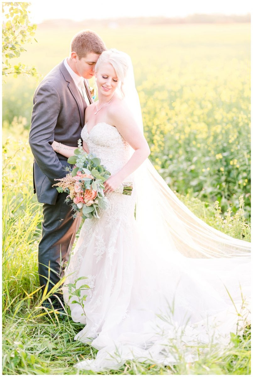 falher wedding photographer in alberta and grande prairie in a field outside wedding photos