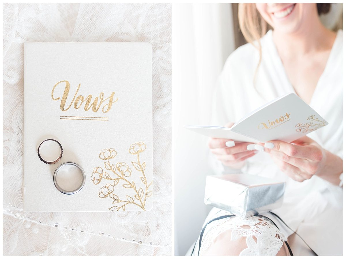 white and gold vow books with wedding rings bride readin at the pomeroy hotel in grande prairie