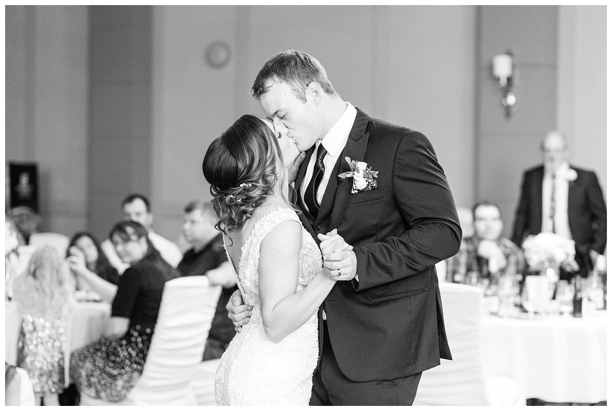 first kiss bride and groom during first dance at the pomeroy hotel wedding in grande prairie