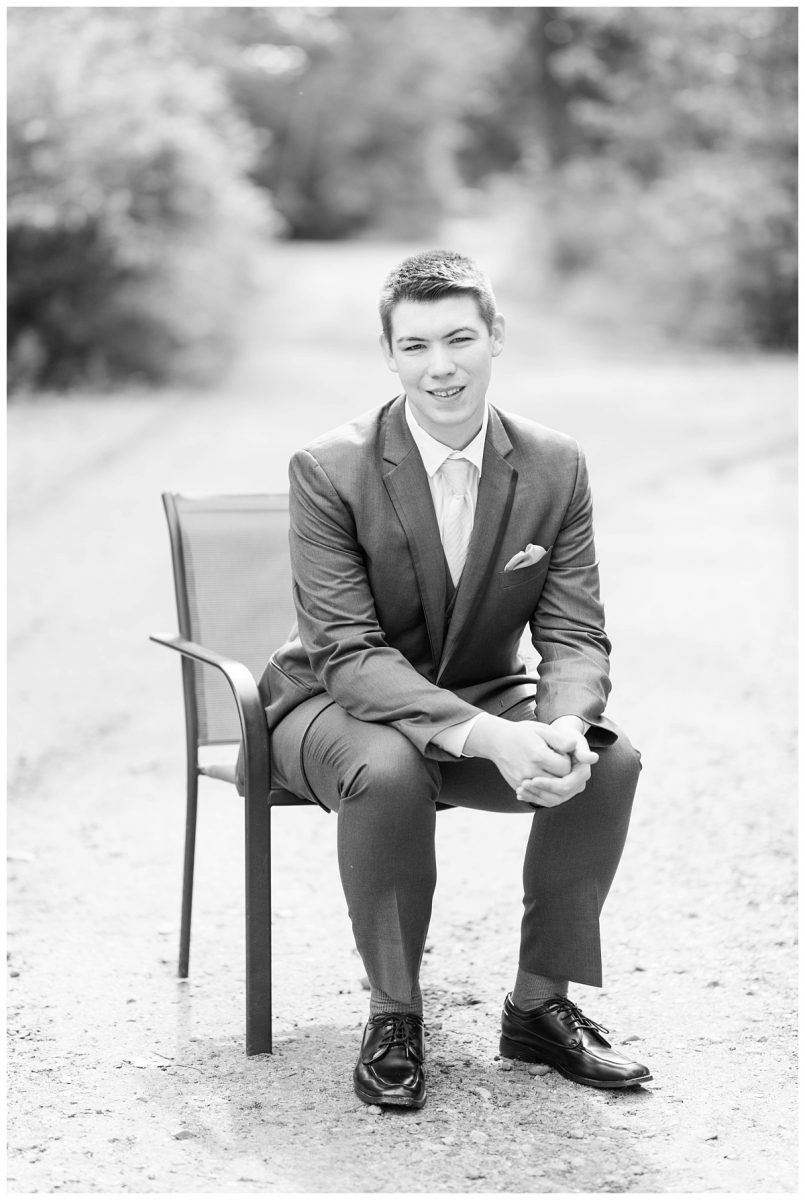 groom chris sitting on chair for his getting ready portraits