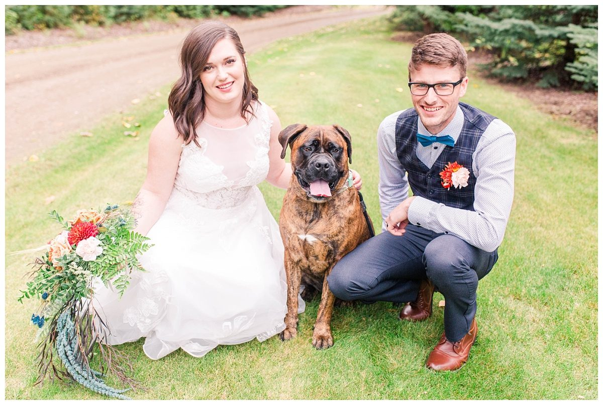 bride and groom with dog during their elopement