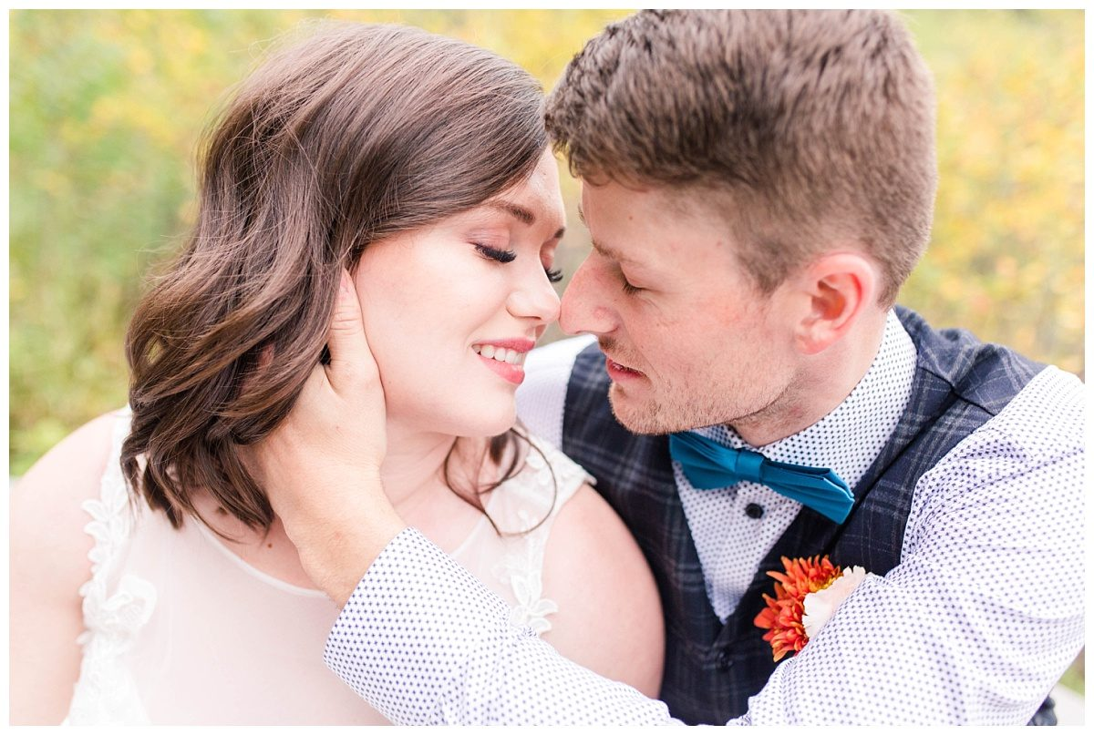 elopement couple at serenity acres in grande prairie very romantic pose cup cheak nose to nsoe wedding photographer in alberta