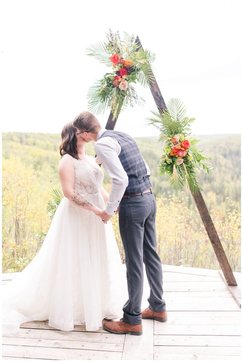 grande prairie elopement photographer at serenity acres ceremony lookout with colors