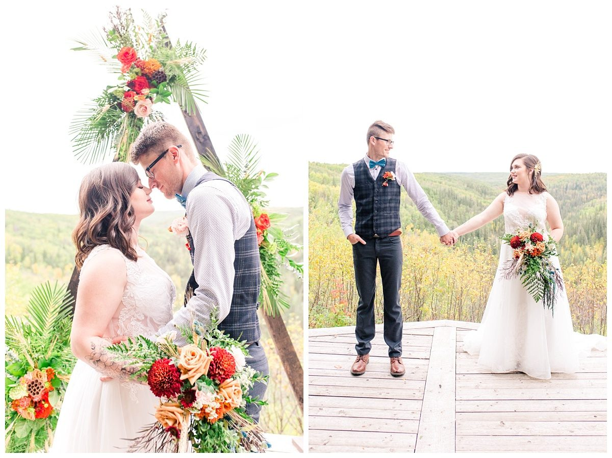 grande prairie alberta elopement at serenity acres holding hands in front of triangle arch with florals and river valley lookout view in the fall with wedding photographer