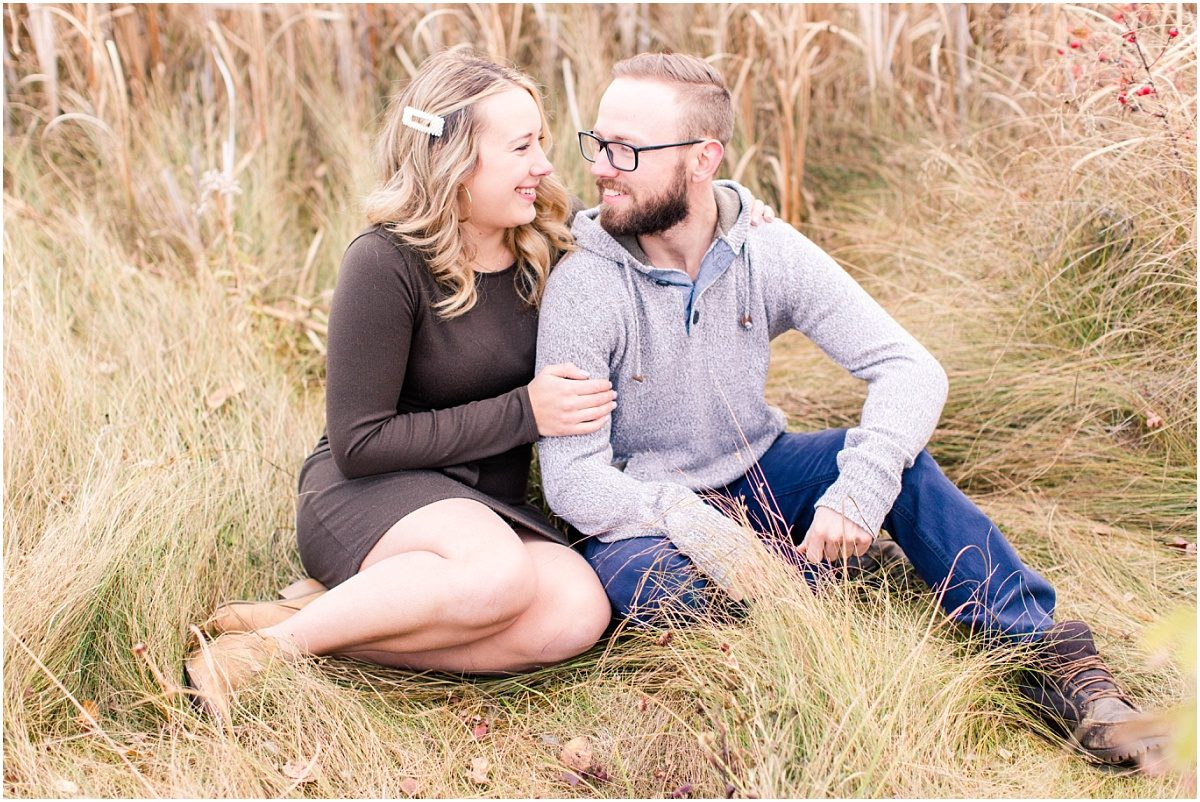 fall october engagement photos with calvin and kelsey in grande prairie wedding photographer in the sitting tall grass