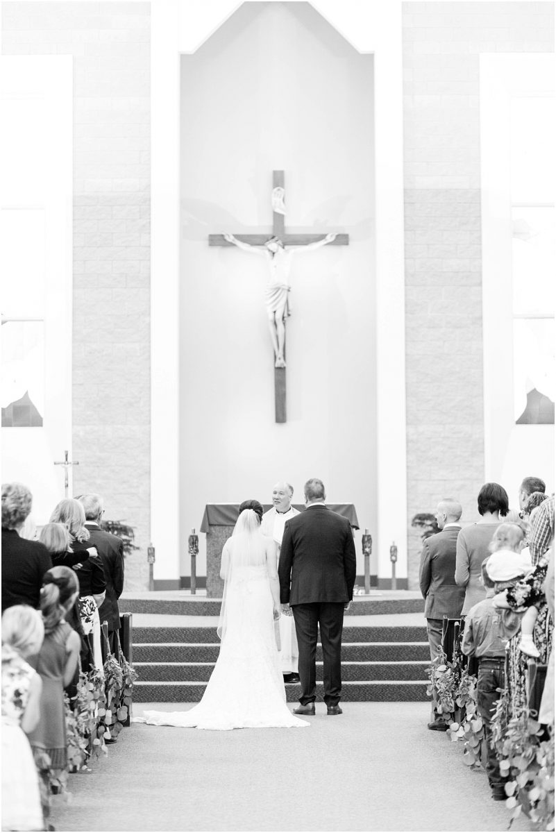 st Joseph catholic ceremony wedding in grande prairie photographer