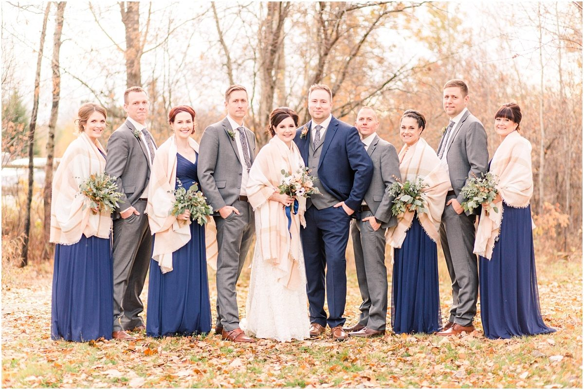fall wedding with navy blue bridal party colors in grande prairie with wedding photographer braden and breanna