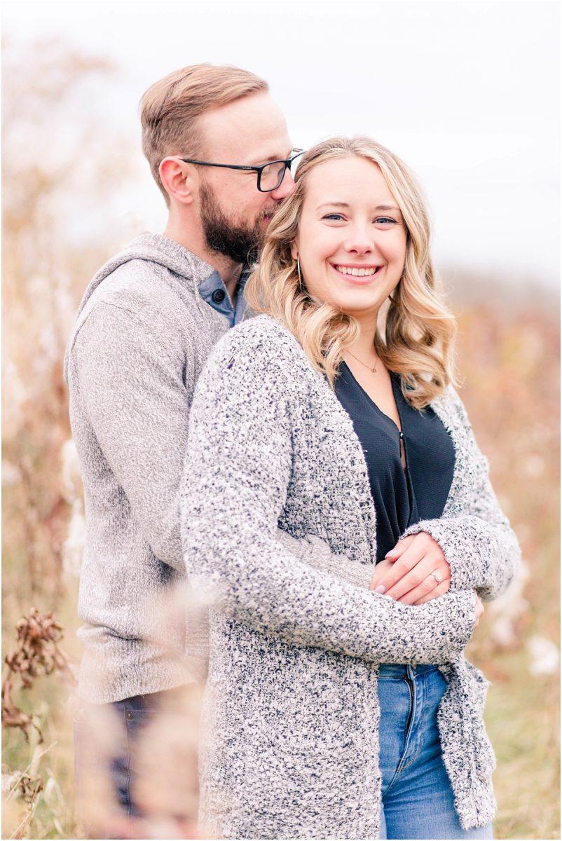 edmonton wedding photographer captured couple engagement photos in grande prairie with grey sweaters