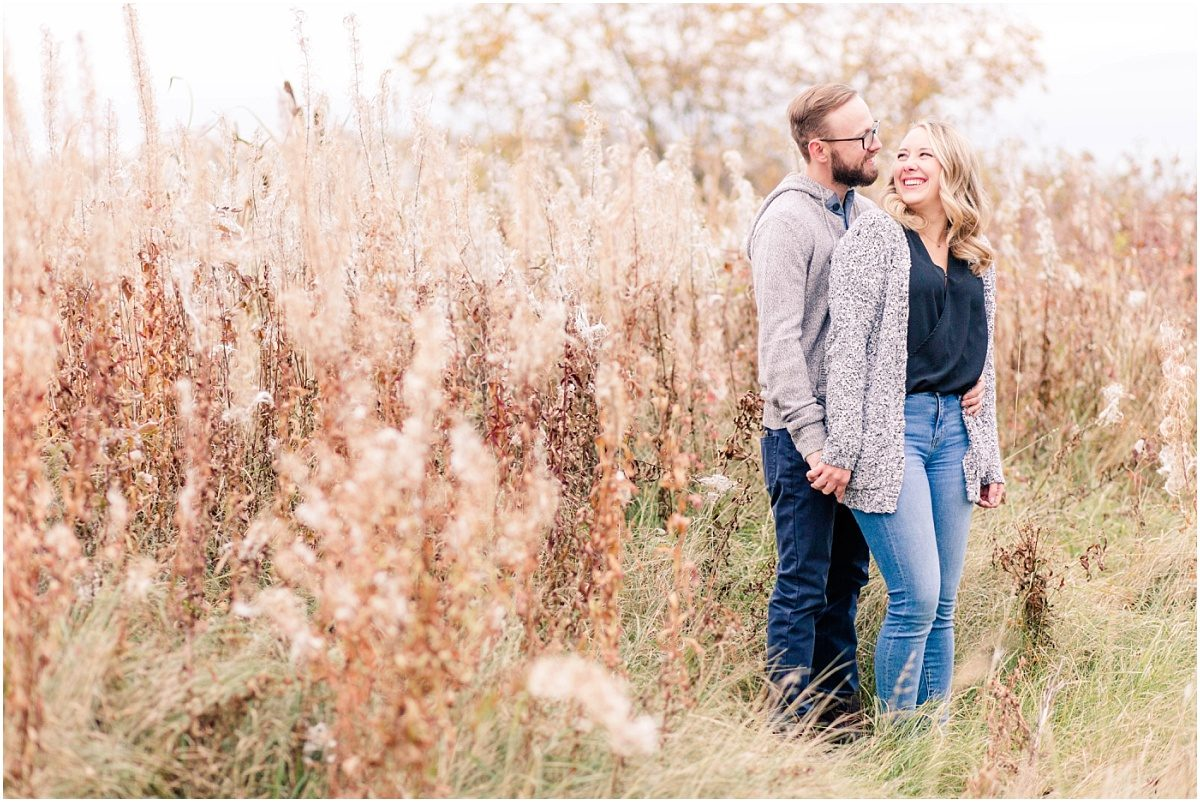 fall phtoos with kelsey and calvin in grande prairie before their edmonton wedding golden grass light and airy happy couple