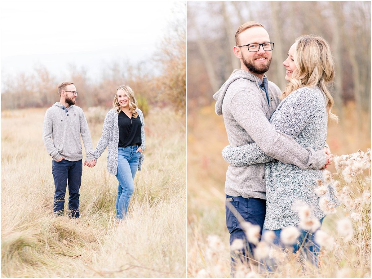 couple holding hands for fall engagement photos in edmonton grande prairie for fall cuddly and cozy
