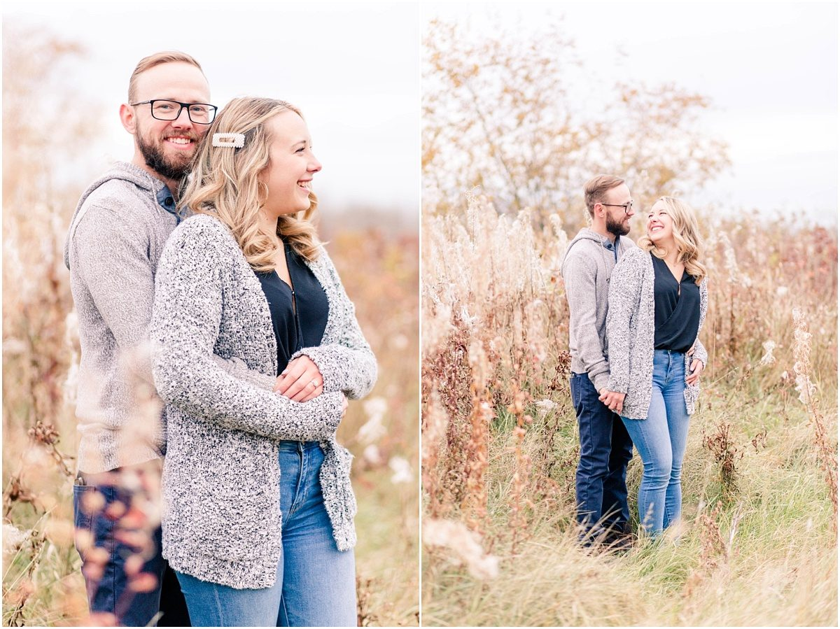 fall engagement photographer in grande prairie groom smiling in tall golden grass for Edmonton couple