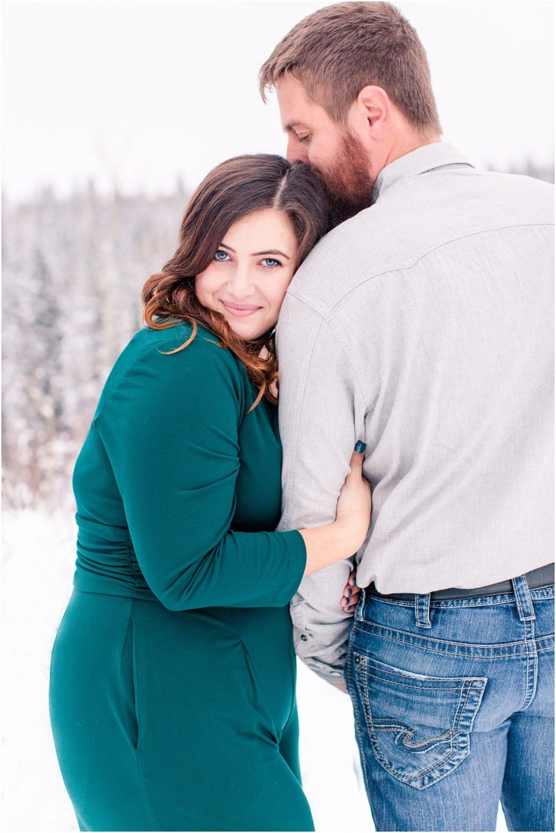 cassidy and cody for their engagement photos in emerald green dress in grande prairie location