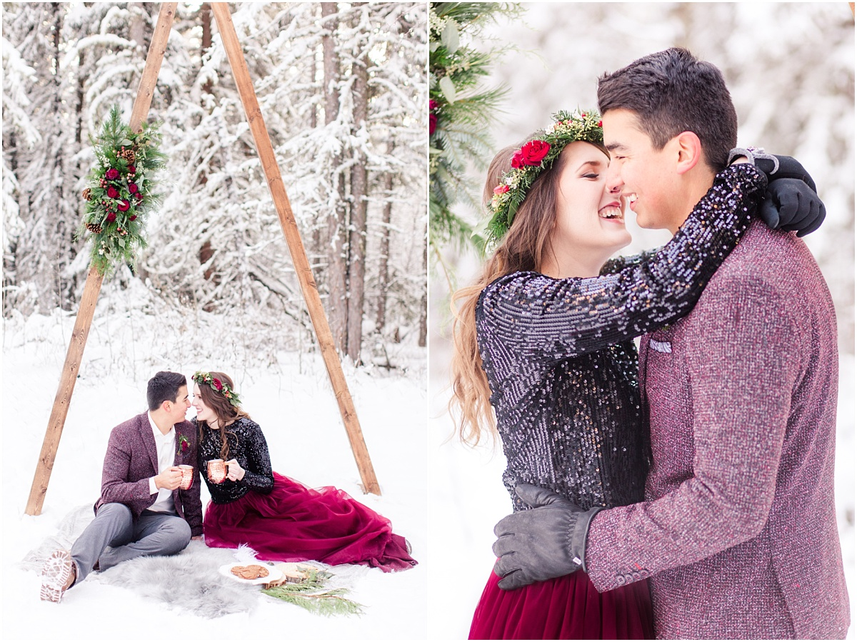 happy couple in winter in grande prairie for their engagement session under triangle arch wedding planner