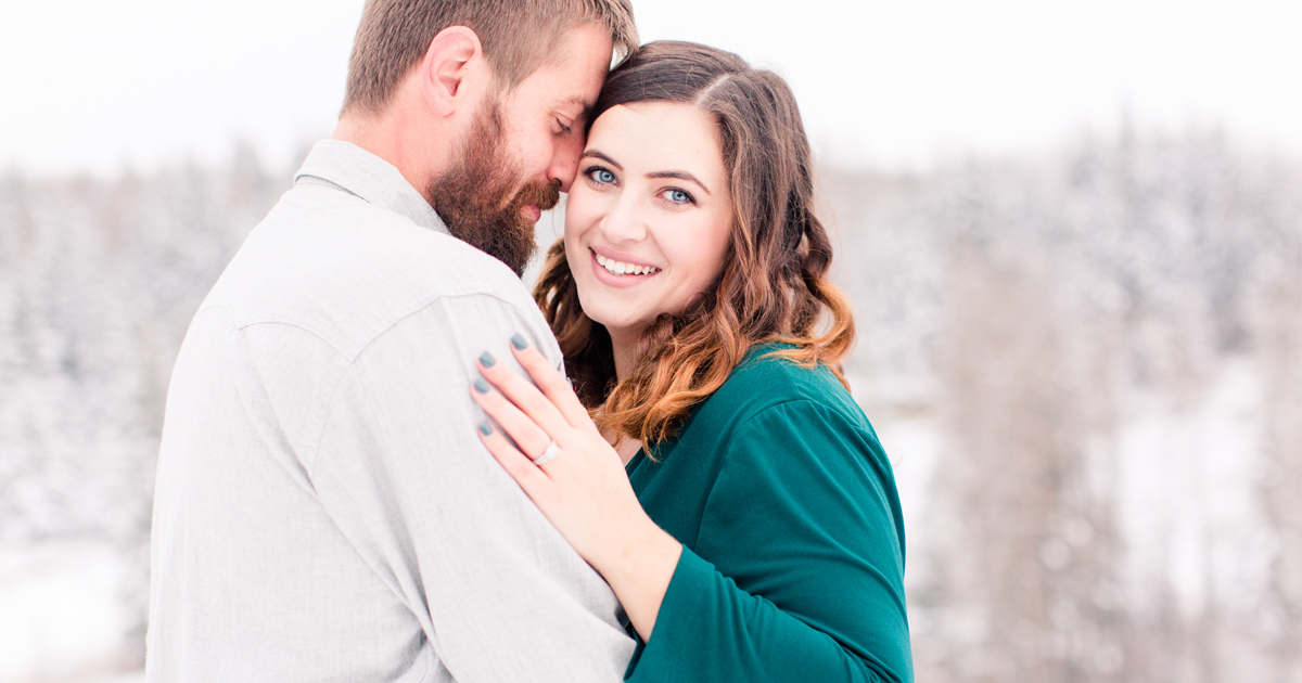 cody and cassidy engagement session with photographer kayla lynn photography in grande prairie close up photo wearing emerald green dress