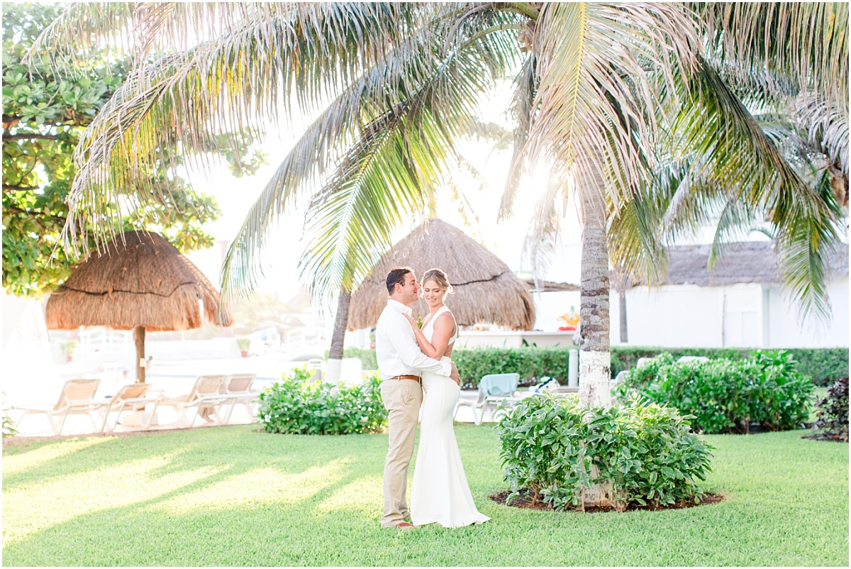 beautiful wedding photography by international destination wedding photographer from alberta in mexico cancun next to the palm trees